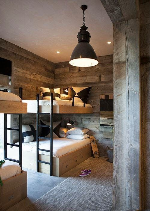 Timber makes everything better! Love this rustic bedroom with twin bunks, timber lined walls and concrete floor.
