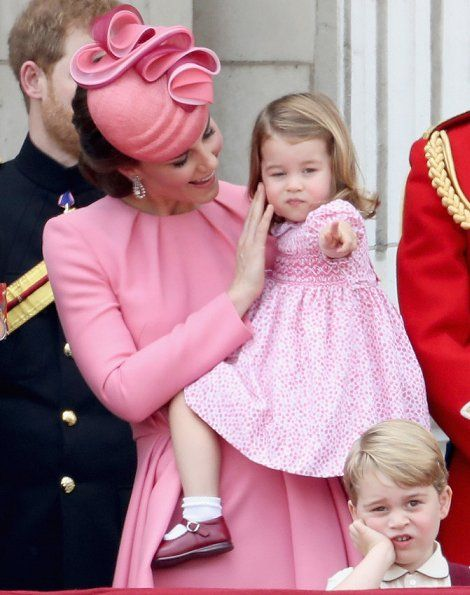 Catherine, Duchess of Cambridge holds her daughter Princess Charlotte at The  Trooping The Colour 2017
