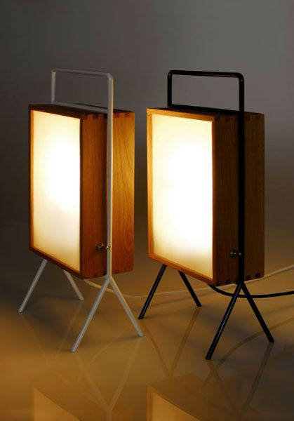 Chick Lamp - minimal portable floor or table lamp, made of oak wood with box joint, white or black laquered iron rod and sandblasted glasses on both sides; chrome toggle switch; simple form created according to the golden section.  Designer Luca Vagnini is still looking for a producer...