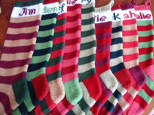 """I am making these as soon as I am not too terribly terrified of the knitting the heel. (o; I have to work up to this project but I just love the color combos this person chose. Definitely going to make the one with the name """"Jim"""" on it. (o:"""