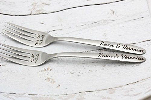 """Stainless Steel Customized Wedding Fork Set. A cute gift for the happy couple! Will be customized with the wedding date and the couple's names. INCLUDED IN YOUR PURCHASE: Set of 2 high-quality stainless steel customized forks CUSTOMIZATION Wedding Date in the XX-XX-XX format. Names of the couple. FAQs Can I use the forks to eat with? Although we feel they are much better used as a """"keepsake"""", they can be used as a utensil and washed easily by hand. No chemicals are used to mark the fork...."""