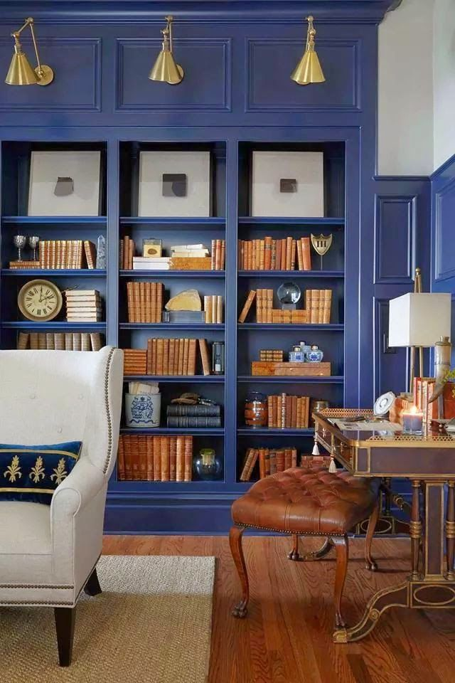 love this color for an office library-Deep blue paint on the wall paneling  and built-in bookshelves transformed this ho-hum library.