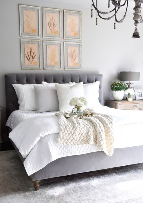 Dreamy white bedding and gray tufted headboard