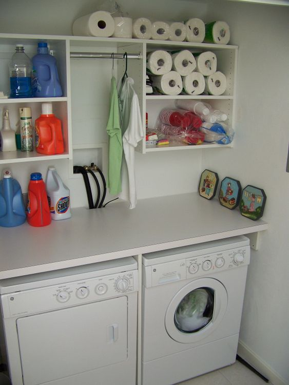 Laundry Room Organization | laundry room organization systems- overstocked paper towels, smart.  I would want containers to hide the cleaning supplies.