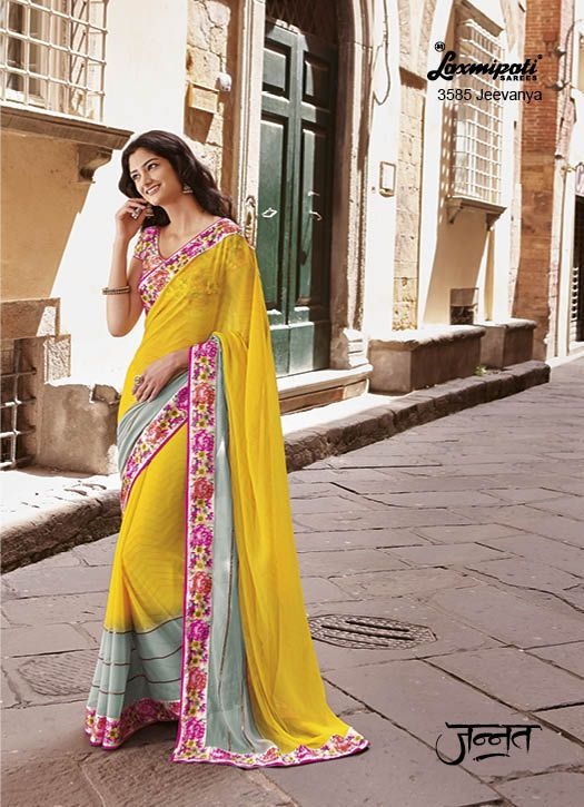Brilliant Bright Gold Coloured Georgette Saree with Padding work of Dragon Green signifying an Epitome of Creativity and Classiness refined by Satin Printed Lace & Gota Work carrying  Multicolour Satin Blouse. www.laxmipati.com