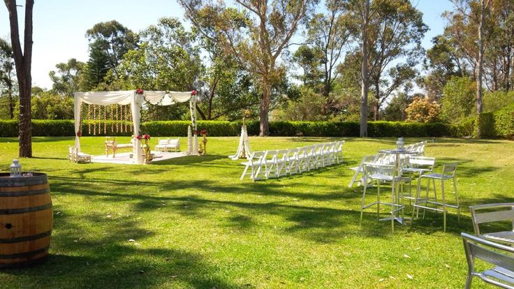 CJ and Arv's beautiful #outdoor #wedding reception on the #Tamburlaine lawn #Hindu #SriLankan ceremony. white #ottomans @TamburlaineWine