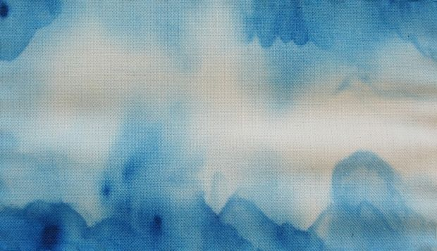 Learn how to paint lovely watercolor-style designs on your own fabrics with this watercolor fabric painting tutorial!