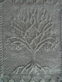 The tree is something I designed, based on the one on Arwen's banner at the end of Return of the King.