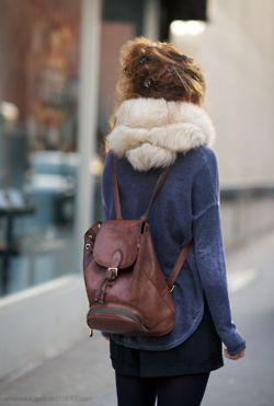 White faux fur snood (infinity scarf) and leather backpack