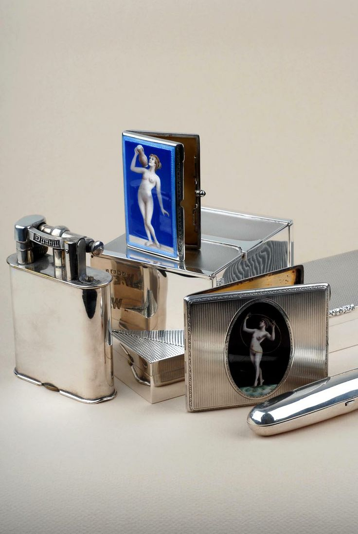 Smokers requisites - vintage silver pocket lighters by Dunhill or Asprey, elegant silver cigarette boxes, antique silver table-top lighters in plain and novelty designs, cigar cases, cigar cutters etc @silvervaultslondon.com