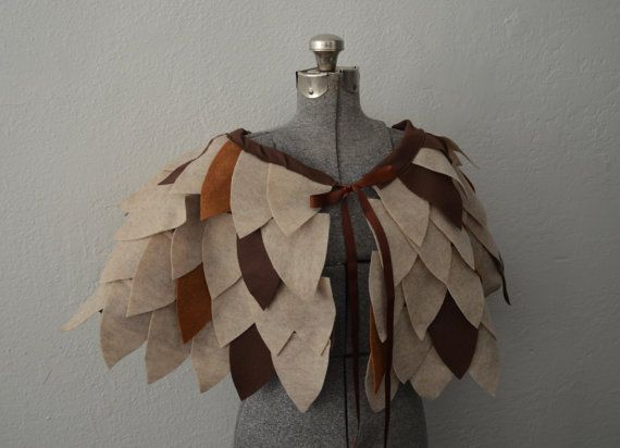 Tan and brow handmade felt owl cape. Ribbon tie in the front.    The cape is about 14 inches from top to bottom and fits most adults.    Colors