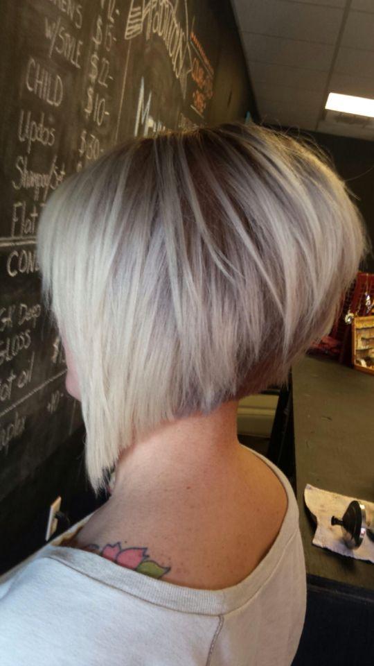 Asymmetrical haircut, short razored cut, angled bob