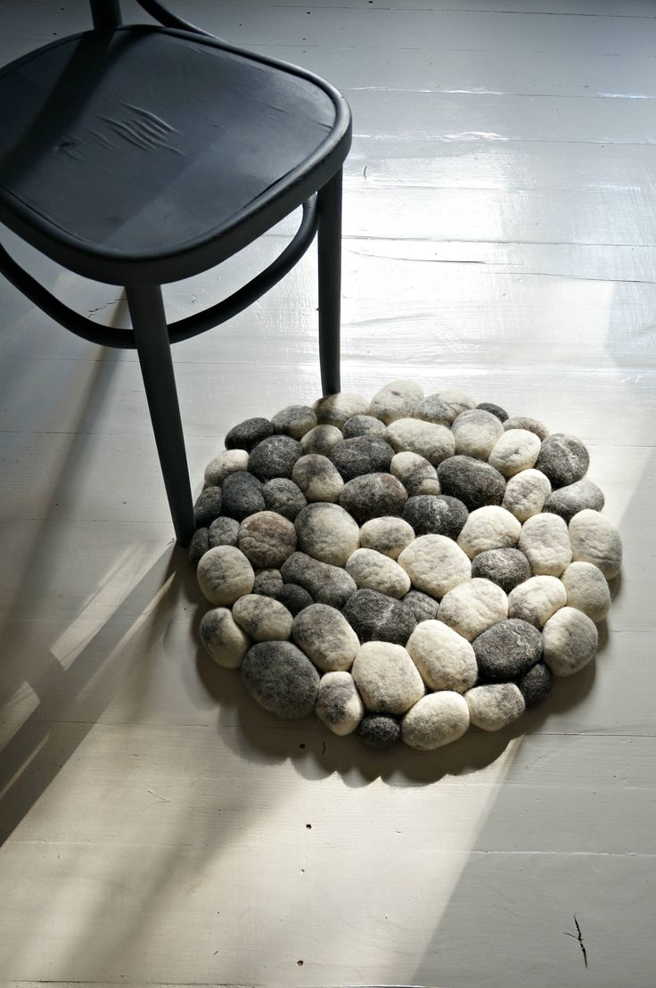 Beautiful, modern and super soft carpet for your Bathroom décor. Bath mat rug is timeless accessory for your Home!  You will feel pleasure of soft wool after you step on your carpet. Yes these rocks looks like real stones from nature. Every felt stone in mat is unique as real pebbles in mother nature. Wool wick water very quick that will be pleasant surprise for your bare foot.  Bring something new and cozy to your bathroom!  Size: 55 cm ( 1,8´ ft). Color: natural white and gray shades…