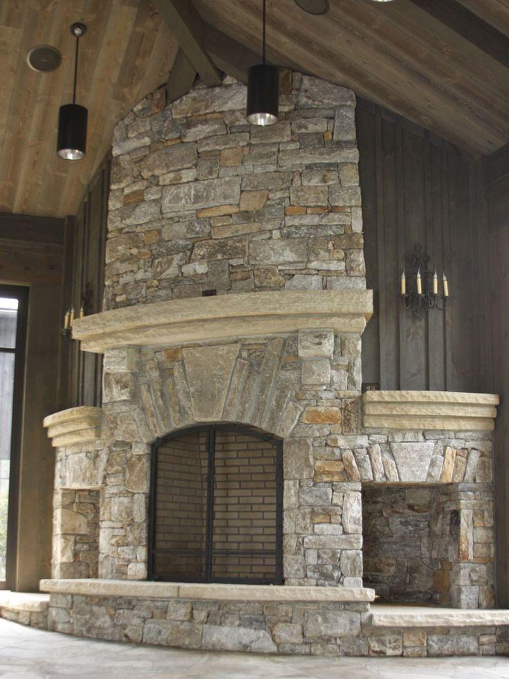 stonefireplacestorage  Native stone fireplace with arch