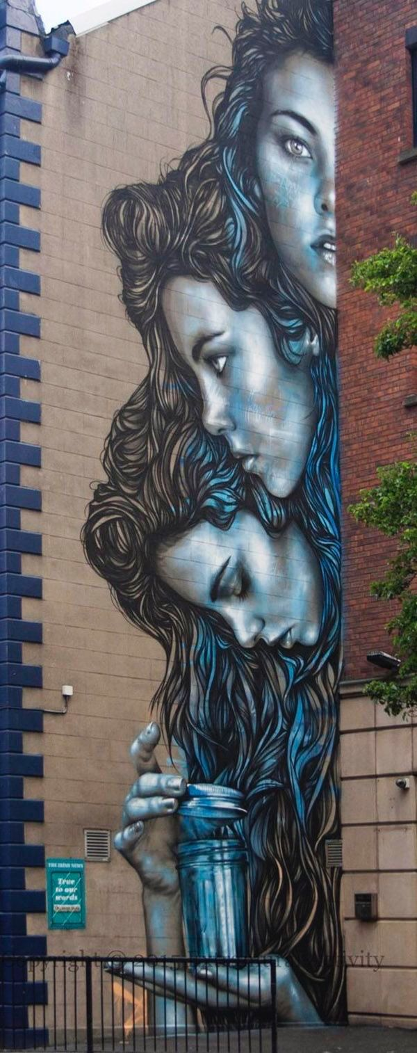 Street art ladies painted on building with gorgeous hair.