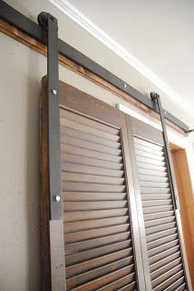 Featured at Do Tell Tuesday: DIY Black Steel Rolling Door Rail