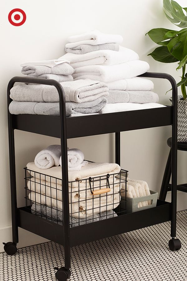 Sharing one bathroom with all your roomies? A bar cart in the is surprisingly chic storage solution for organizing towels or toiletries when space is limited.