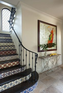 tiled staircase with iron railing