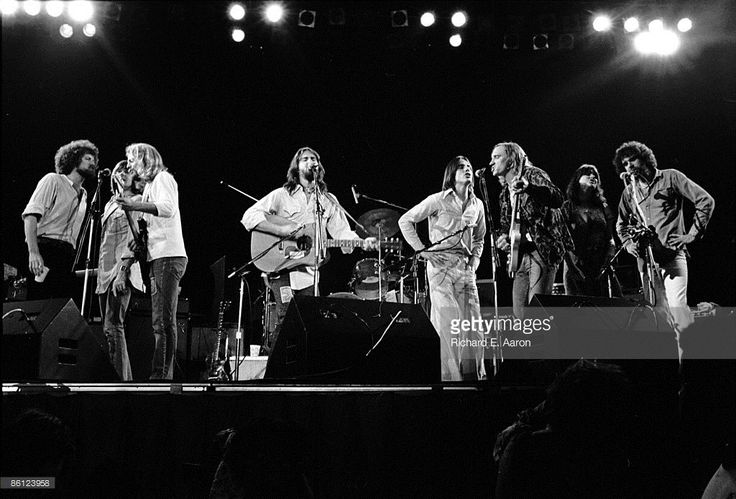 Photo of EAGLES and Linda RONSTADT and Jackson BROWNE and Dan FOGELBERG and Joe WALSH and Don HENLEY and Don FELDER and Randy MEISNER and Kenny EDWARDS; (L-R) Don Henley, Randy Meisner, Don Felder, Dan Fogelberg, Jackson Browne, Joe Walsh, Linda Ronstadt and Kenny Edwards performing on stage at a benefit for California Gov. Jerry Brown at the Capital Centre in Largo, MD. May 14, 1976.
