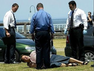 Williams is arrested in Port Melbourne on November 17, 2003. Photo: The Age/ Angela Wylie