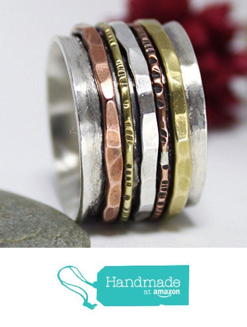 Hammered Sterling Silver, Brass & Copper Spinner Ring. Hammered Ring, Statement Ring, Meditation Ring, Silver Spinner Ring from rosajuri https://www.amazon.com/dp/B01M6E289J/ref=hnd_sw_r_pi_dp_cUh1ybSWQVBWB #handmadeatamazon