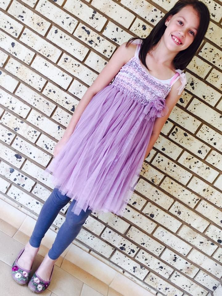 Another satisfied customer! Pretty Lerinda wearing our Purple Foxglove Crochet Tutu Fairy Dress. Custom Designs available contact www.momentswithmom.com or visit us on Facebook @MomentswithMomClothing