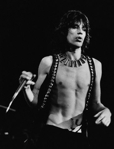 Oh Rose! Jagger performing in 70s grunge leather waistcoat.