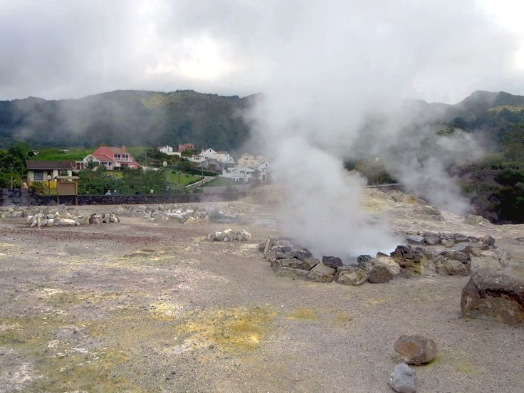 Steam and hot water bubble up from fumaroles in the town of Furnas on Sao Miguel Island, Azores.