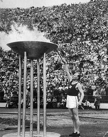 1952 Summer Olympics Paavo Nurmi and the Olympic Flame. *** Paavo Nurmi (b. 13 June 1897) *** http://en.wikipedia.org/wiki/Paavo_Nurmi