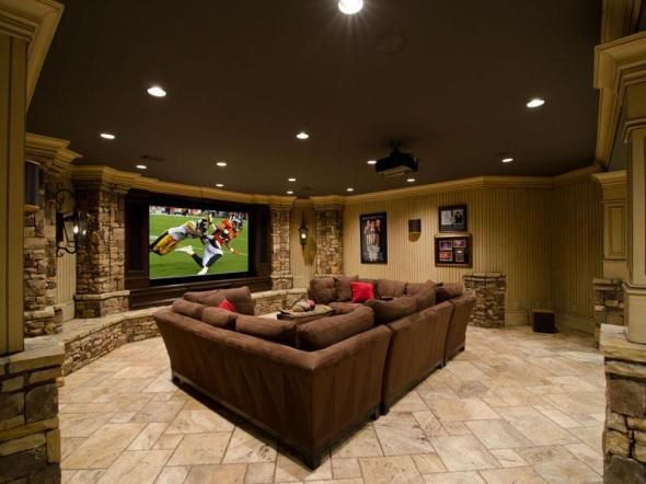Now that's a legit basement. This wreck room set up can keep the guests relaxed and in party mode at the same time. The colors keep the room warm. And the bricks liven it up with texture. Cant go wrong with this idea.