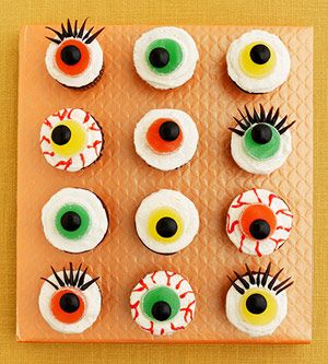 Frost #cupcakes with white frosting and have an assortment of candies and frosting set out for guests to decorate their own eerie eyeball cupcakes!