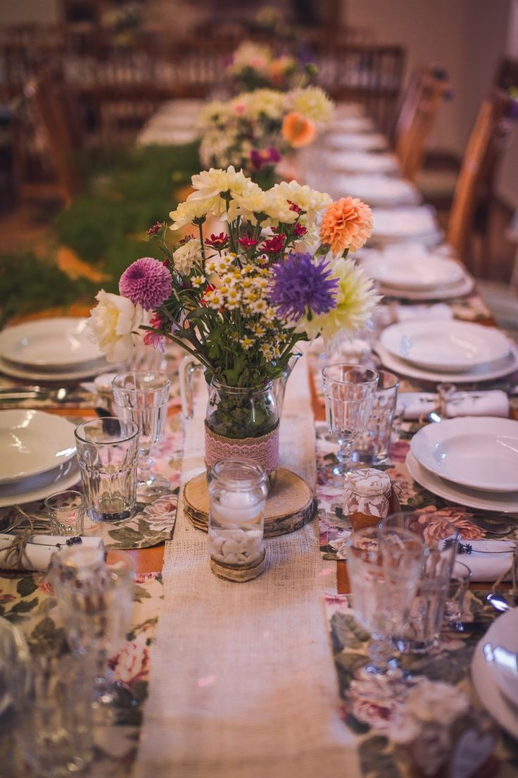 Bouquets on the tables. Candles in water.