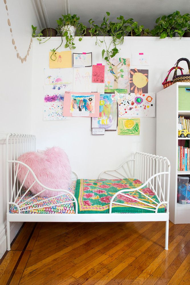 how a family of four lives comfortably in 650 square feet art wall in a cute kids room - Kids Room Wall Design