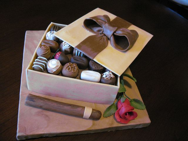 Birthday cake love this idea..make panels of fondant ahead of time so they have time to dry out a bit then place on frosted or fondant covered cake,.then add fondant chocolates or real truffles as well..