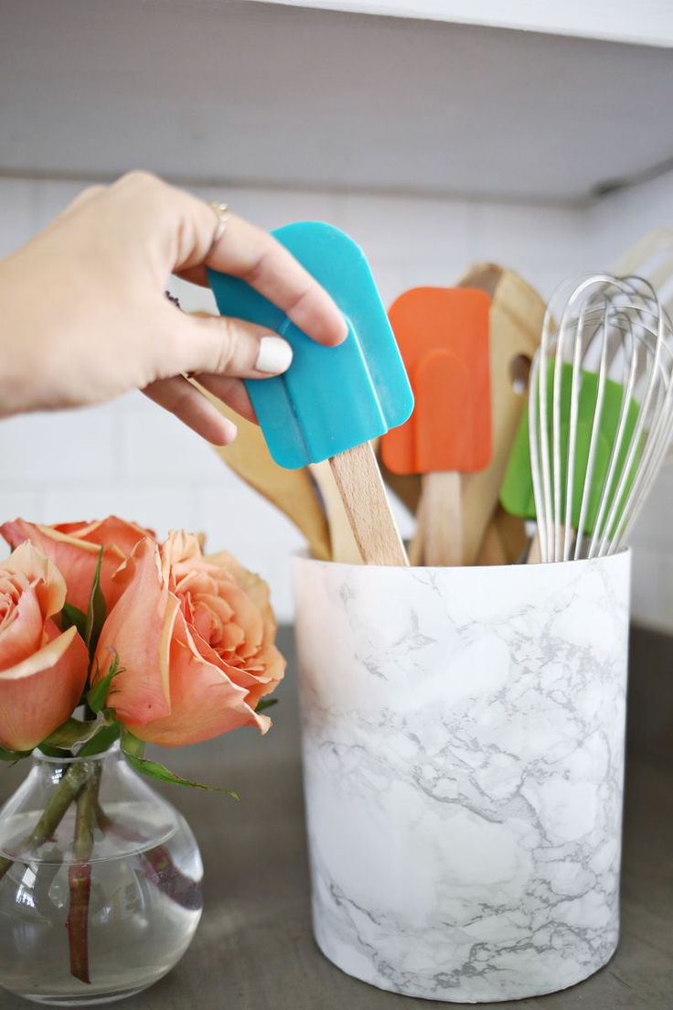 Re-cover your utensil holder with marble contact paper for a inexpensive