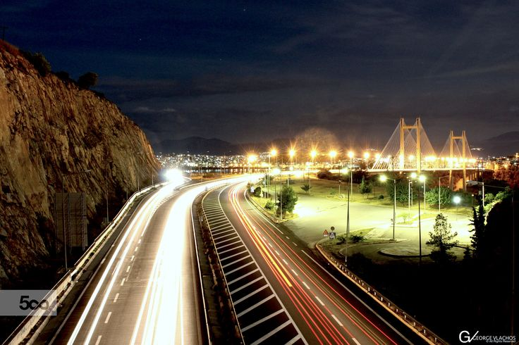 Light trails of the cars traveling across the high bridge of Evripos in Chalkida, Greece.