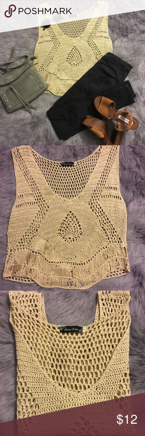 Downtown Coalition knit top Beige knit top from downtown Coalition. Loose fit and under shirt or bralette can be worn underneath. Small stain on the bottom left (can be seen in photos).  This top will be a great addition to your closet! It can be dressed up with a black bralette, black jeans, and strappy heels or dresses down with jean shorts and converse 💛 Downtown Coalition Tops Tank Tops