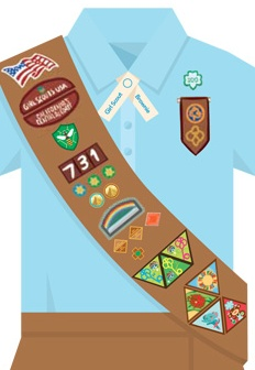 Here's the GS Brownie uniform sash. Note the Safety Award pin affixed above the Brownie Quest Journey badges. This award is available at every GS level now - read about the requirements for it in the Girl's Guide to Girl Scouting.