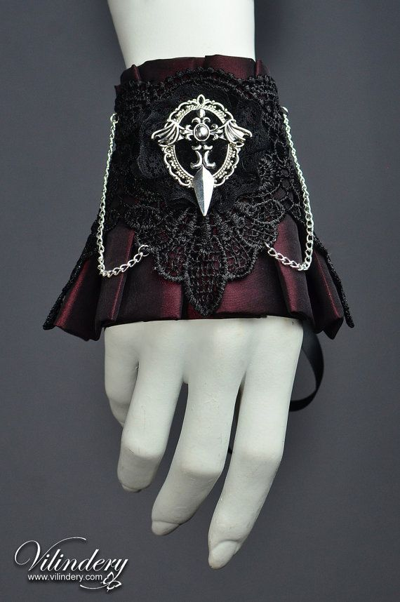 ● Gothic cuff ● Victorian style ● Vampire jewelry ● Lolita Fashion ● This beautiful Vampire style inspired cuff bracelet is unique Vilindery design and has been handmade with love and care. The fabric is very soft and fades from black to wine red, depending on the light. Cuff is adjustable with long satin ribbons. The length of the cuff around the wrist is 5.9 (15 cm) + long satin ribbons. We have no problem making this cuff bigger or smaller on your request for a perfect fit…