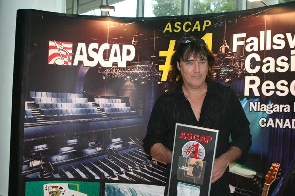 "Songwriter David Lee Murphy receives a plaque at the ASCAP No. 1 party for ""Big Green Tractor"" on Sept. 29, 2009."