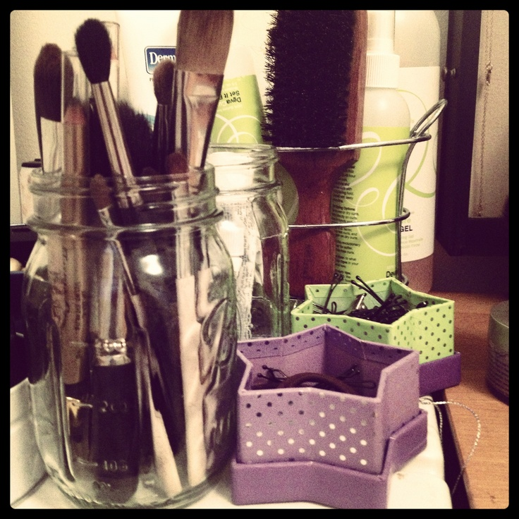Mason jar as makeup brush holder. HP gift boxes as hair accessory holders.