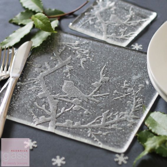These stunning handmade glass placemats will make your dining table look gorgeous this winter. Each placemat in embossed with a robin in a tree and sprinkled with glass snow. Matching coasters are available too. They will be carefully packaged in white tissue paper with a gift tag. 20 by 20 cm