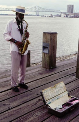 A local sax player fills the air with his sounds along the Mississippi River.