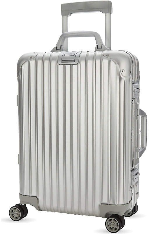 9c230f921a Rimowa Topas four-wheel cabin suitcase 55cm. Crafted from stylish and  hardwearing aluminium, the spinner includes a multi–directional wheeling  system and a ...