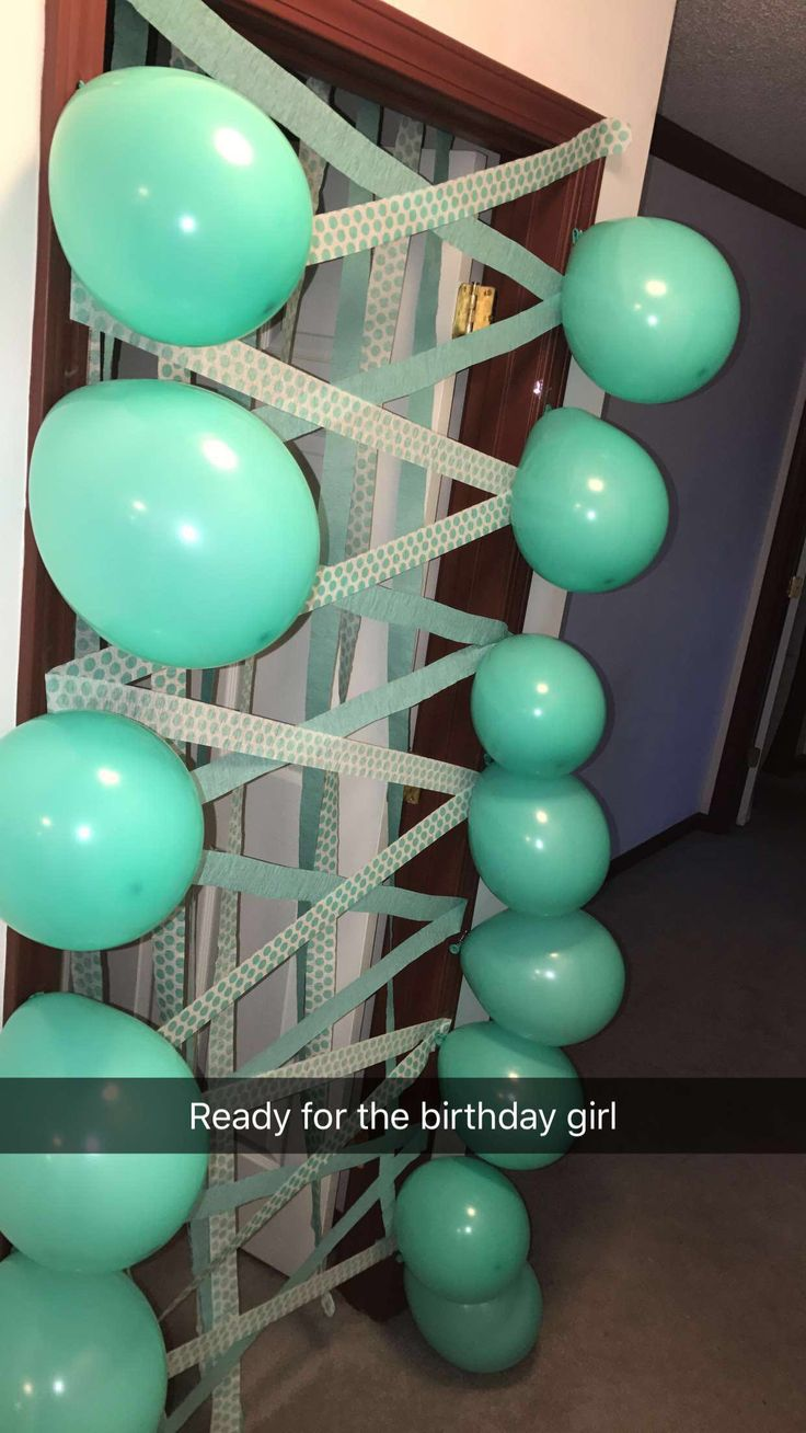 Surprise for the birthday girl. Door full of balloons and streamers. Birthday decor