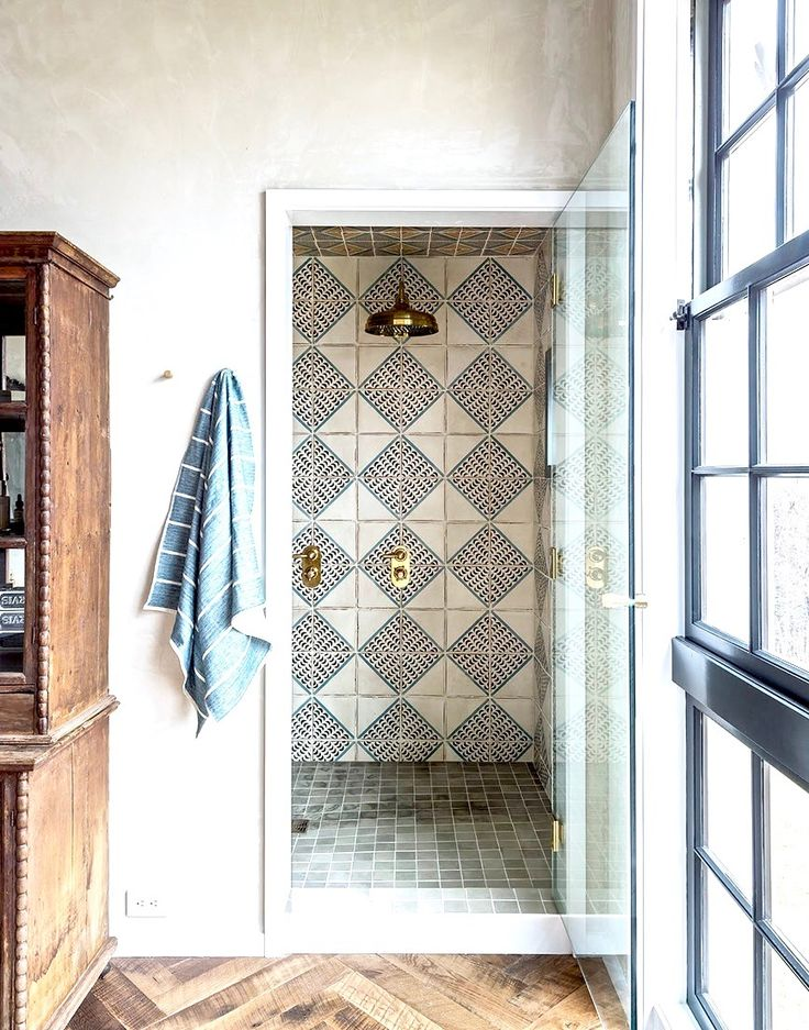 2018 tile trends. Hand painted terracotta tiles add character and charm to two farmhouse rustic bathrooms. Tiles by Tabarka Studio. Rooms by Jennifer Bunsa.