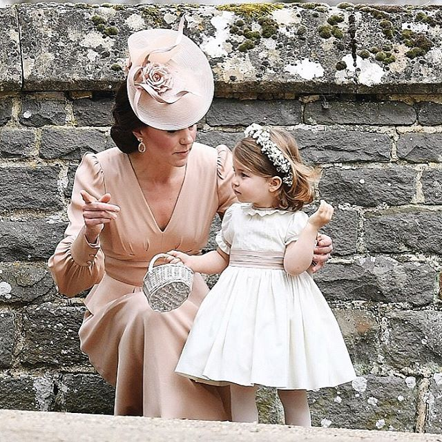 The Duchess of Cambridge and daughter Princess Charlotte at Pippa Middleton's wedding 20 May 2017
