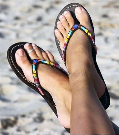 Fabulous chocolate leather beaded sandal with a beautiful beaded leather flip flop strap in a selection of vibrant colours. This is a must have for a casual beach look.    This product is handmade in Africa    Thong Style Sandal    Genuine Dark Leather Upper (dyed & sun dried) with contrast white stitching    Flat Flexible (non slip) Rubber Sole    Hand-cut uppers and soles    All bead work sewn by hand