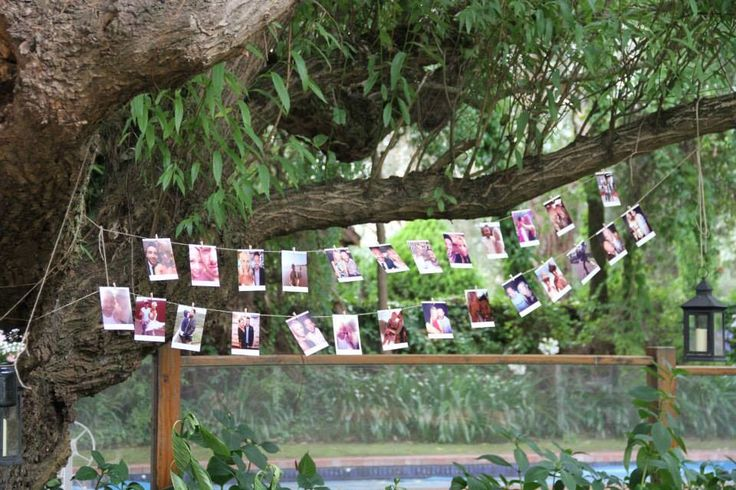 Photo board with a rustic twist  I had these photos printed to a square cut size to make them look like a polaroid I brought mini pegs from my local craft shop and used some brown string to tie to the tree and hung each photo like so! It looked so pretty and was a different way of displaying photos !