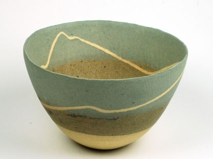 Charlotte Jones Ceramics - inspired by lines of surf out at sea. Thrown base in coloured stoneware with added coils. Bowl then cut into two and white line added. Pot reassembled, pinched and burnished.